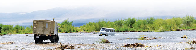 Research vehicles must ford rivers to reach some remote sampling sites in Mongolia. (Photo courtesy of Alain Maasri.)