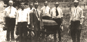 Herrin Mayor A. T. Pace (foreground) flanked by United Mine Workers of America officials as they move the body of the first victim. Note the coffin's beveled and chamfered corners. Photo courtesy of Williamson County Historical Society. This photo originally appeared in the Chicago Tribune.