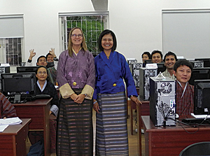 Karen Beardsley and Canserina Kurnia dressed in traditional Bhutanese attire while teaching ArcGIS Online at Royal Thimphu College, Bhutan.