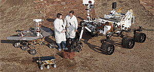 A variety of Mars rover designs have been used to accommodate different terrains and ensure successful mobility. On the lower left, Sojourner was active during 1997. On the upper left, the Opportunity rover, which has remained active since 2004, shares the same design as the Spirit rover. The Curiosity rover, active since 2012, is shown in the upper right.