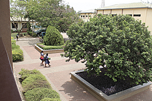 Students stroll across the SOS-Hermann Gmeiner International College in Tema.
