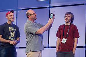 Nick Volpe (on right) and Jeremy Folds (on phone) accept the first-place award for their entry in the 100-lines-or-less-js code challenge.