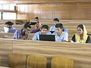 Youth Mappers in a chapter at Khulna University digitize field notes onto the map. They collaborated with two other chapters in the United States on this project. Photo/Chad Blevins