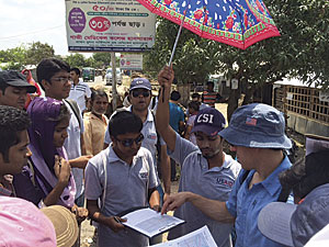 Chad Blevins from the USAID GeoCenter traveled to Bangladesh, where he provided instruction to Khulna University students as they prepared for a day of field mapping.  Photo/Michael Crino