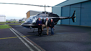 Captain John Lane, owner of helicopter rental company Heliflight; Clive Langmead, pilot for WLE; and Anneley McMillan, Helyx GIS consultant getting ready for the test flight in England.