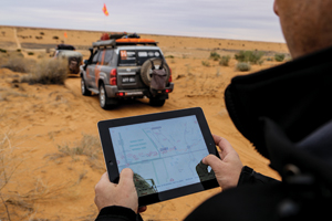 A Map Patrol team member captures a waypoint with the HemaExplorer app during an expedition through the Simpson Desert.