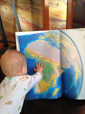 Miller familiarizes himself with the National Geographic World Atlas.