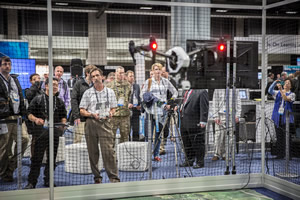 Drones will maneuver inside a netted cage at the Esri Imaging & Mapping Forum.