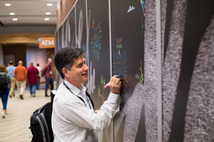 DevSummit attendees left creative messages and drawings on a chalk board inside the Palm Springs Convention Center.