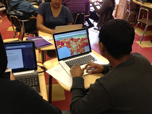 An 11th grade student in Los Angeles uses Esri technology to study demographics.