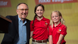 Esri president Jack Dangermond congratulates fourth graders Rikki Vaughan (middle) and Kylie Miller on their presentation.