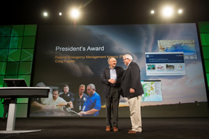 Esri president Jack Dangermond congratulates FEMA administrator Craig Fugate for winning the Esri President's award this year.