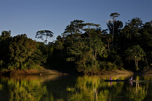 Resl found an affinity for the Amazon. Here, a canoe skims across the waters in Yasuni, a rainforest in northeastern Ecuador that's the ancestral home to the Waorani people.  Photo/Kelly Swing.