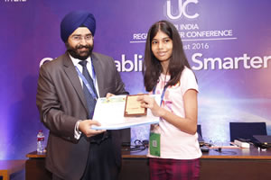Harpreet Singh from Esri India presents the third place award in the Esri India Story Maps Contest to Mahika Srivastava.