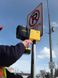 The city of Ames' traffic staff performs retroreflectivity testing.
