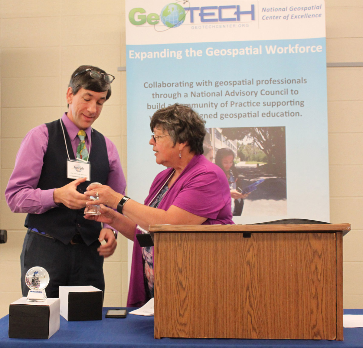 Joseph Kerski Receiving GeoTech Center Lifetime Achievement Award From Ann Johnson